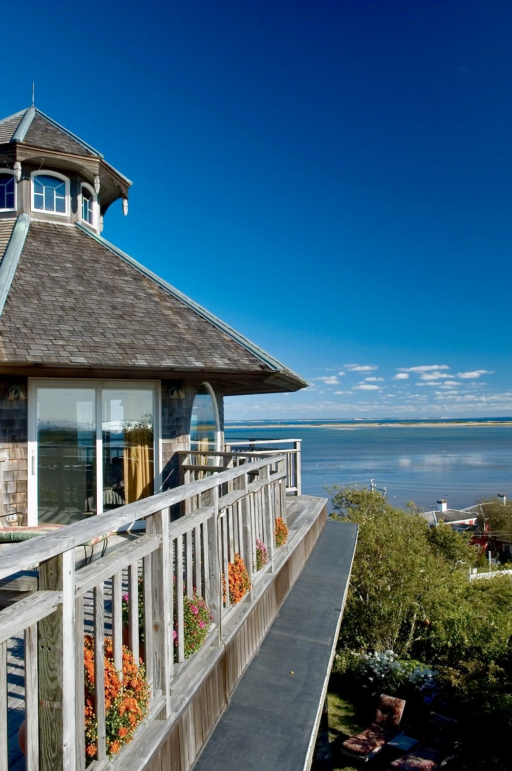 A picture of the Lands End Inn overlooking the water in P-Town
